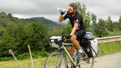 Reza-drinking-on-bike-1024x576